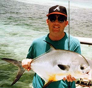 A happy permit angler! This fish was released to fight another day. Image © Sean Morey