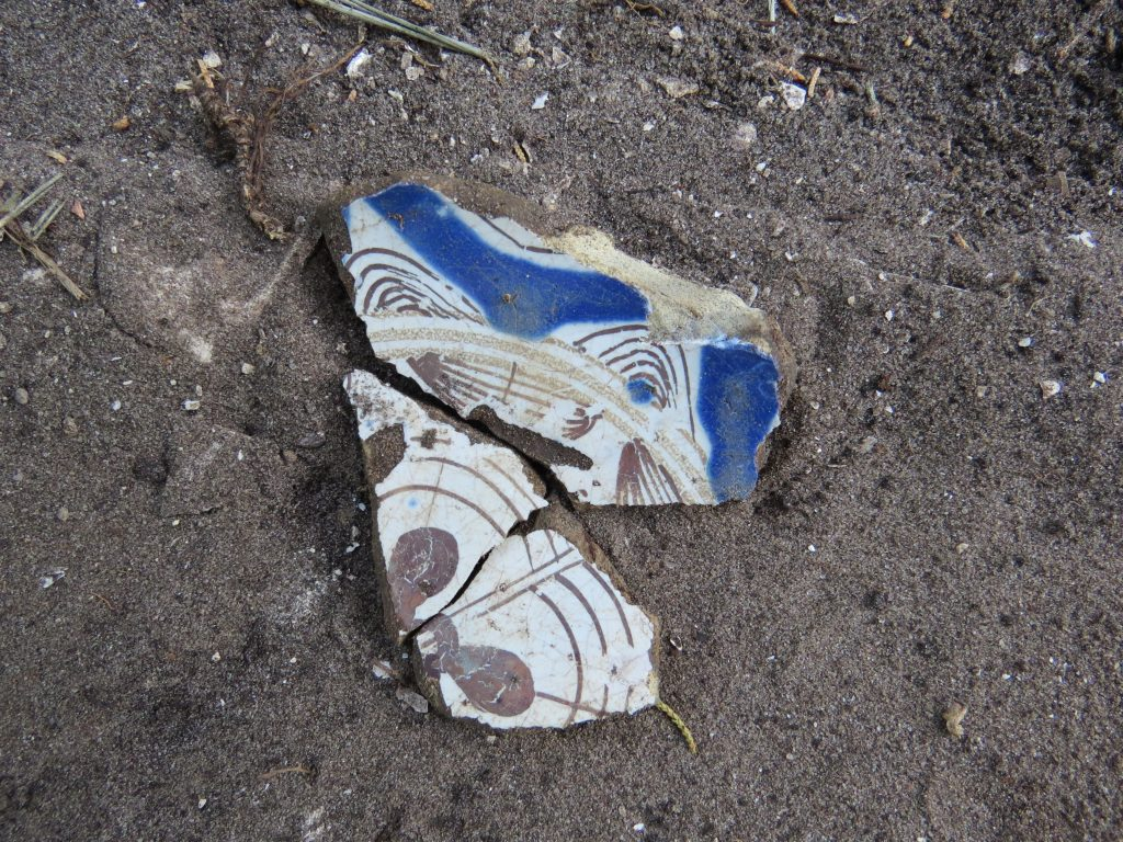 pottery sherds in dirt