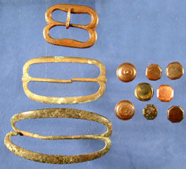 Uniform buttons and bandolier buckles