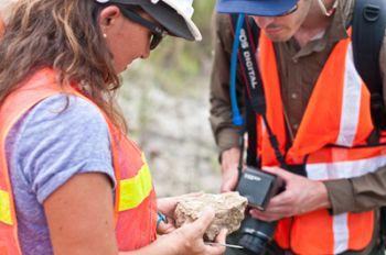 PCPPIRETeach (now GABI RET and iDigFossils) Project Coordinator Claudia Grant and Santa Cruz teacher Michael Lynch examine a rock for fossils during the PCPPIRETeach 2013 trip to Panama. Photo courtesy of Robert Hoffman.