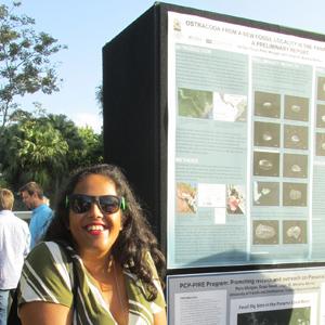 My poster and I at the Symposium. Photo courtesy of Marta Moreno.