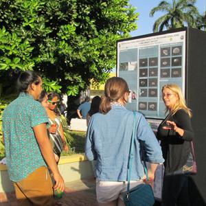 Paris Morgan presenting her poster to members of STRI at the Fellows and Intern Symposium. Photo courtesy of Paris Morgan.