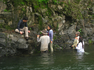 The majority of our time was spent hiking up rivers, where rocks were exposed by running water. Pictured above, a group of students from the University of the Andes discuss the orientation and lithology of an outcrop of basalt in Rio Verdadero. Plant growth in the rock's cracks (fractures and faults) highlights patterns in the orientations of such features. Noting the primary direction and orientation of fractures can give information about regional stresses and tectonic changes. Photo courtesy of Gina Roberti.