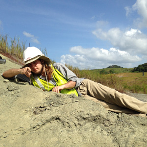 Adam Bouché brushing away sediment to search for fossils at the Panama Canal. Photo courtesy of S. Westacott.
