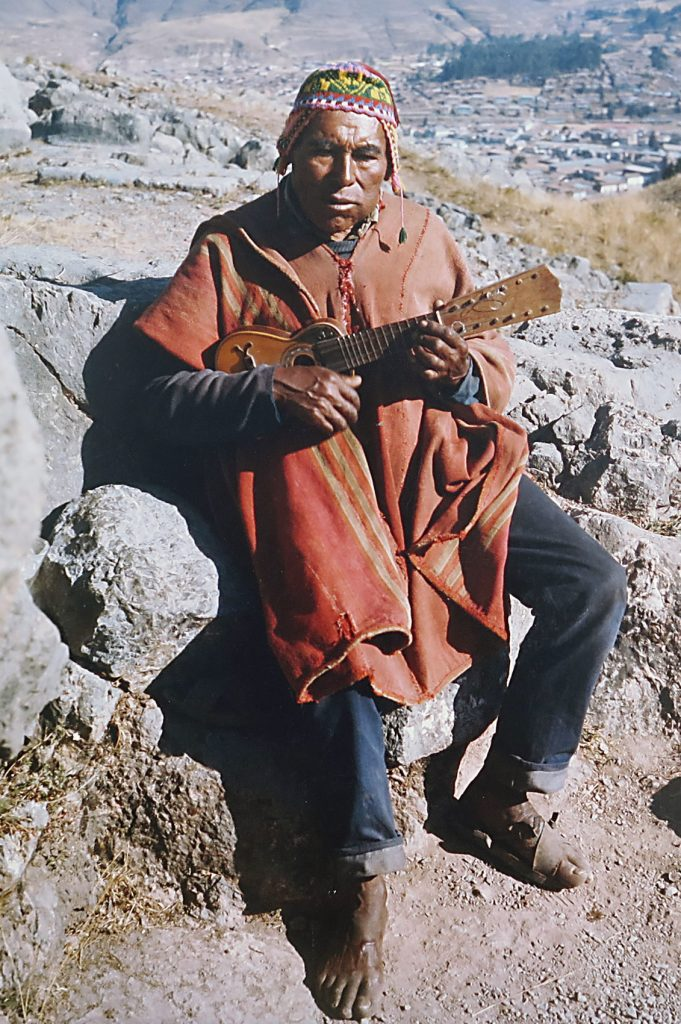Andes man playing instrument