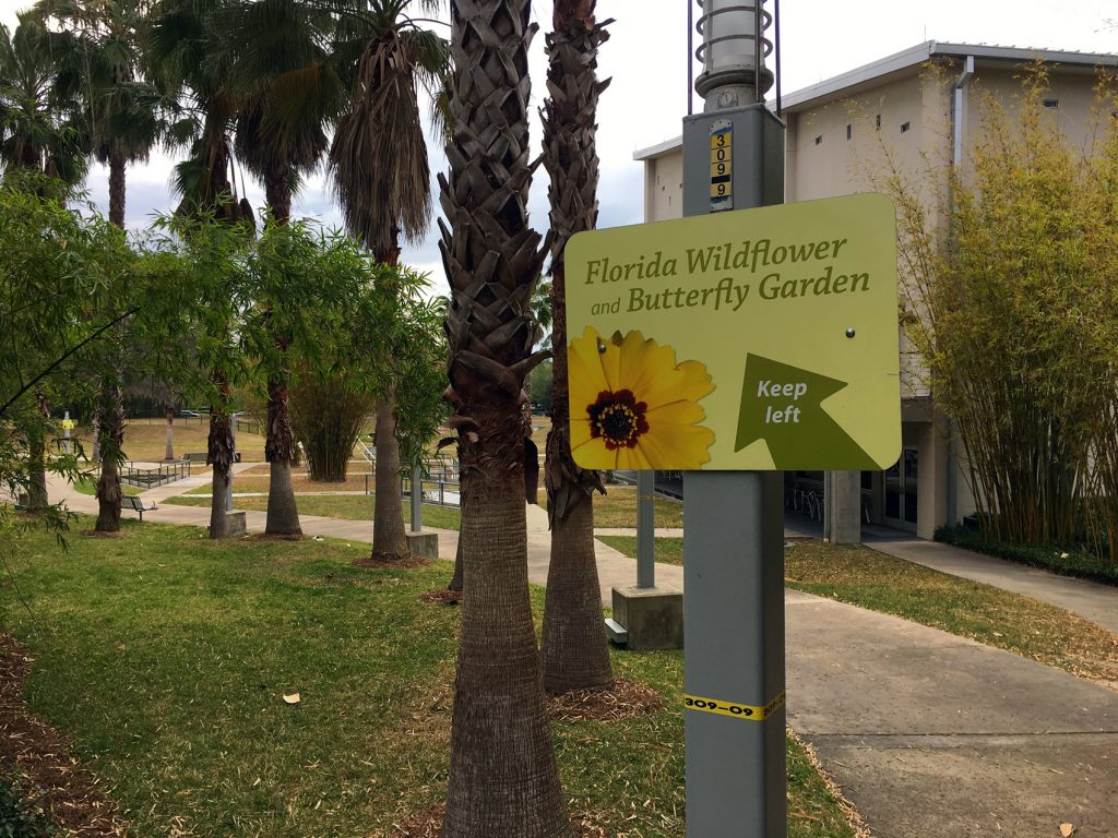 sign pointing to wildflower garden