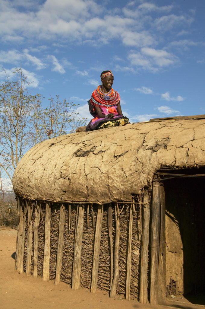 Samburu woman on dung hut