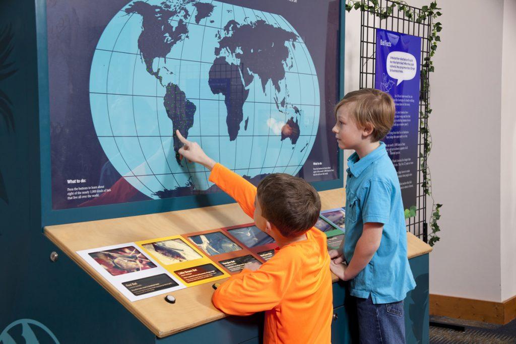 visitors looking at world map