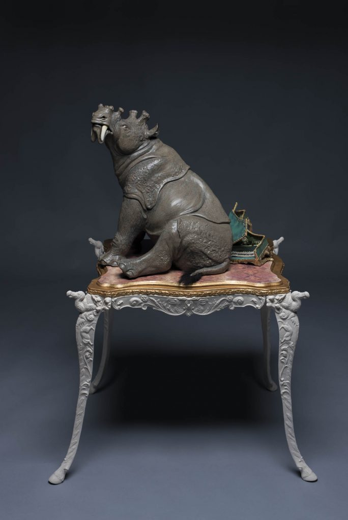 "This sculpture of Uintatherium crushing a harpsichord is one of five sculptures in the ""Wondrous Creatures"" showcase. ©Photo courtesy of Joshua Hobson"