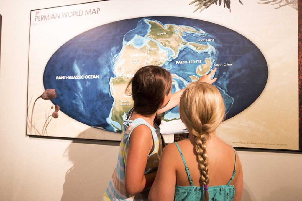 """Maps and touch-screen game stations allow visitors to learn more about life during the Permian Period in the """"Permian Monsters: Life Before the Dinosaurs"""" exhibit, on display at the Florida Museum in Gainesville Sept. 29, 2018-May 5, 2019. ©Photo courtesy of Denis Smith"""