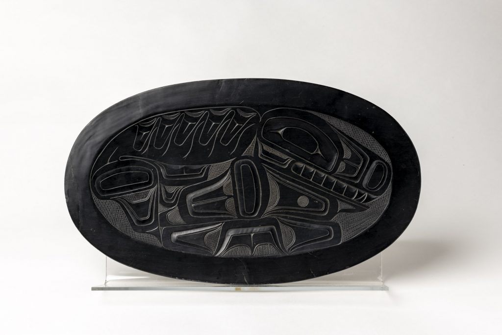 This shallow argillite platter shows an incised conventionalized killer whale in the basin. ©Florida Museum photo by Kristen Grace