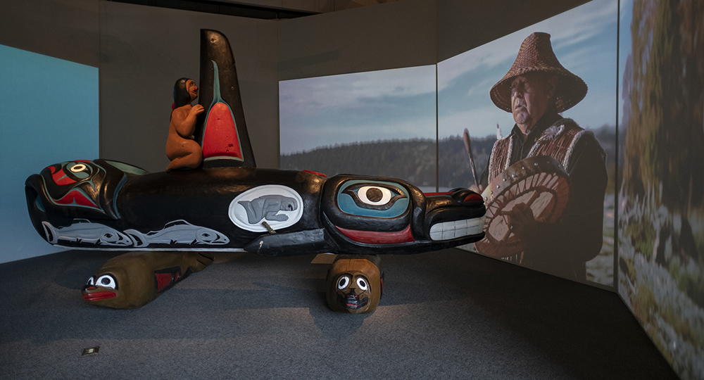 The exhibit marks the first time the totem has been inside a museum. The killer whale rests on two 8-foot-long seals. ©Florida Museum photo by Kristen Grace