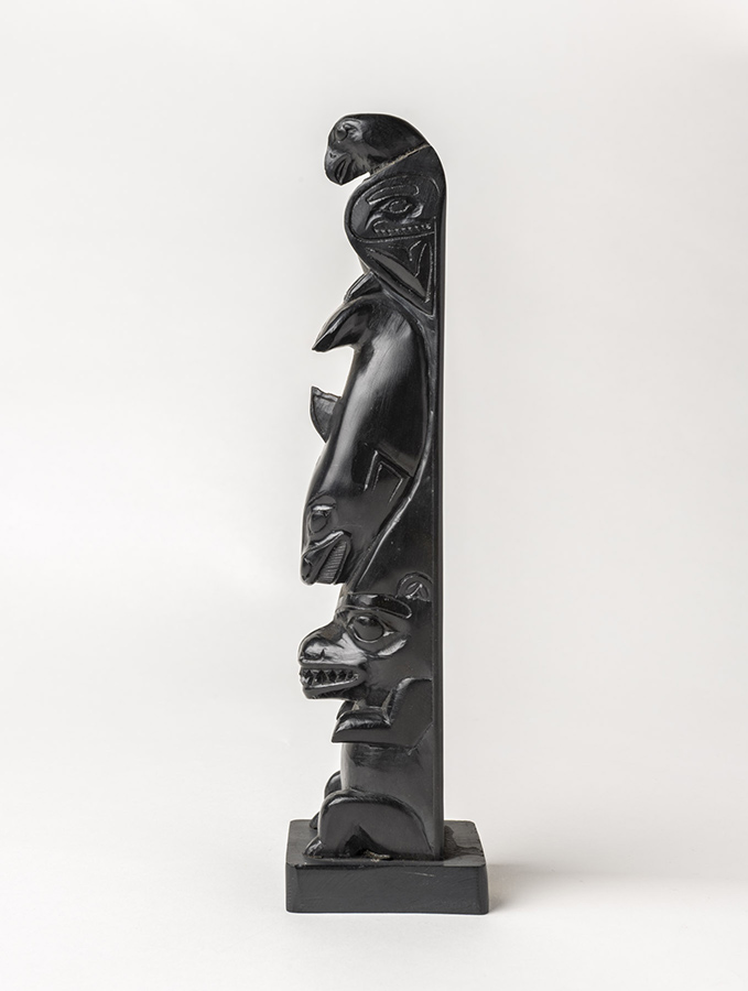 This carved totem includes a bear, a killer whale and an eagle. ©Florida Museum photo by Kristen Grace