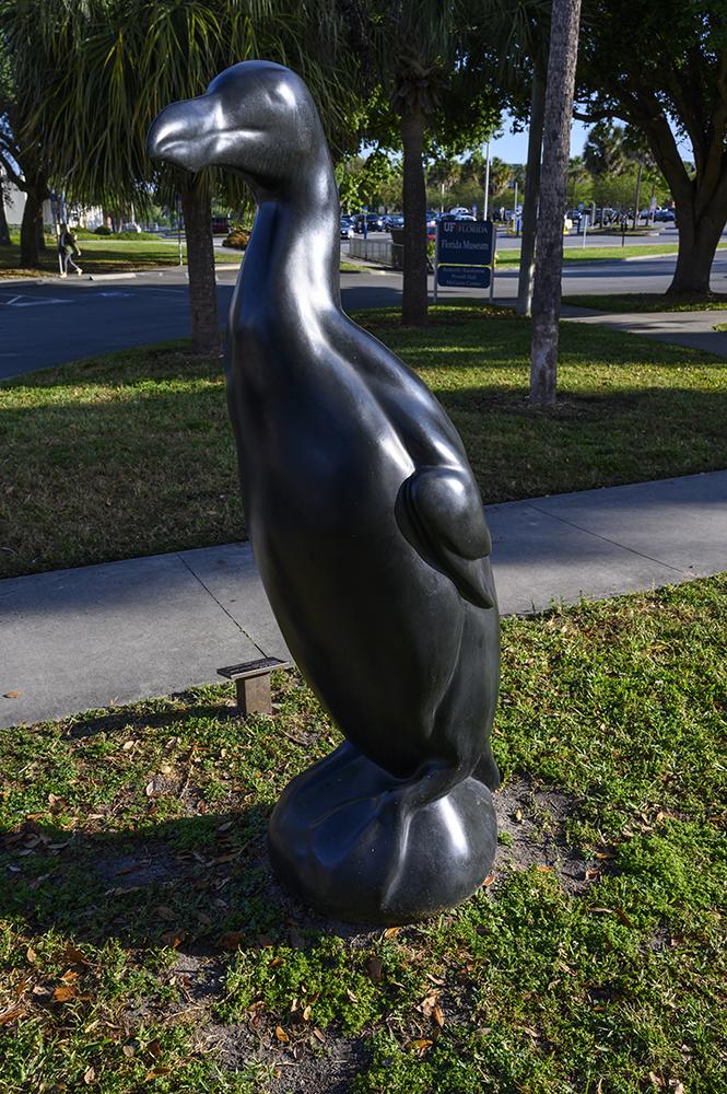 Bird statue on lawn