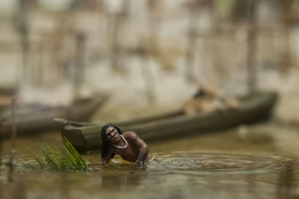 diorama close up of a person moving in water