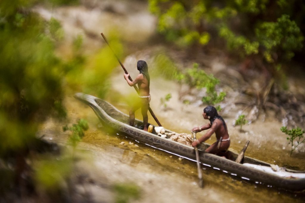 diorama close up of two native people in a canoe