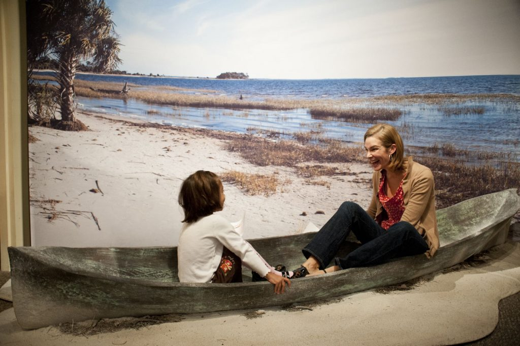 woman and child sitting in a canoe