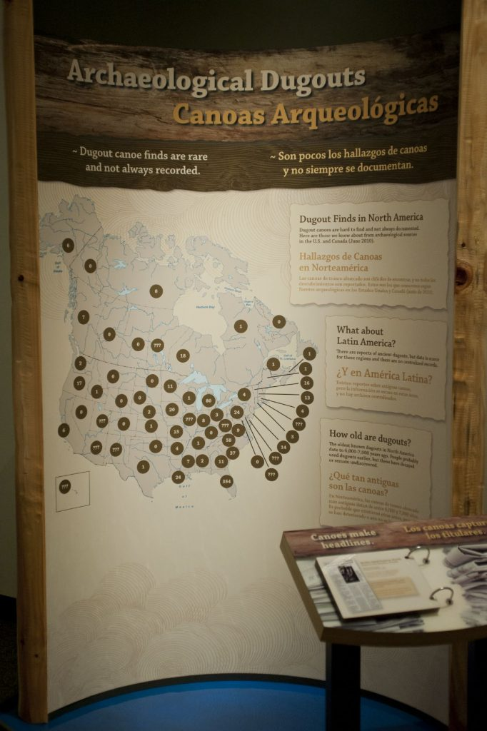museum panel showing locations on map of US and Canada