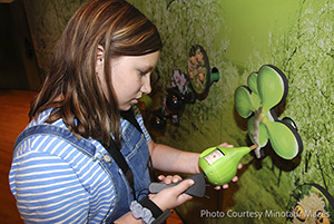 person interacting with exhibit