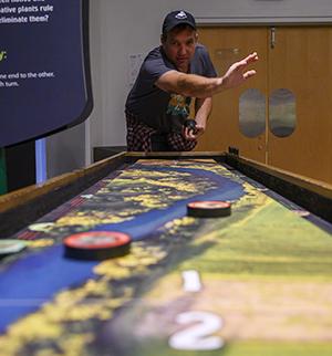 person playing shuffleboard
