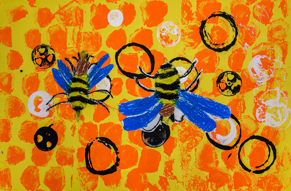 Painting of two black and yellow bees with blue wings on orange and yellow honeycomb.