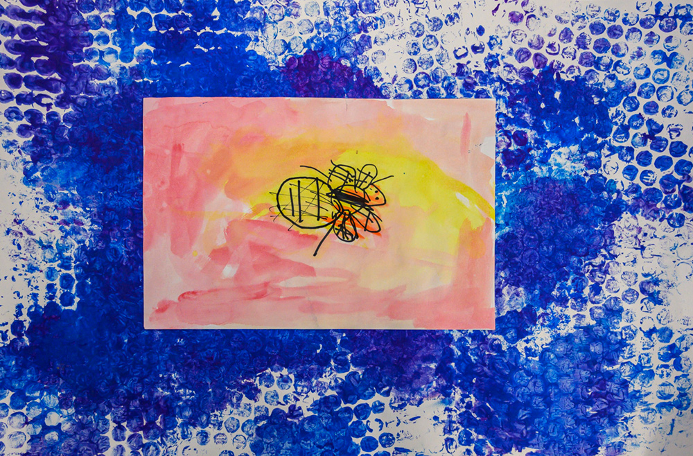 Painting of a yellow, black, and orange bee.