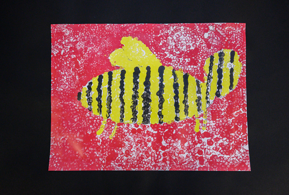 Painting of a yellow and black bee against a red background.