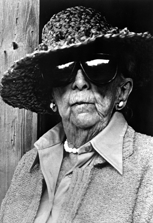 Photo of Douglas, unsmiling, with black sunglasses and straw hat.