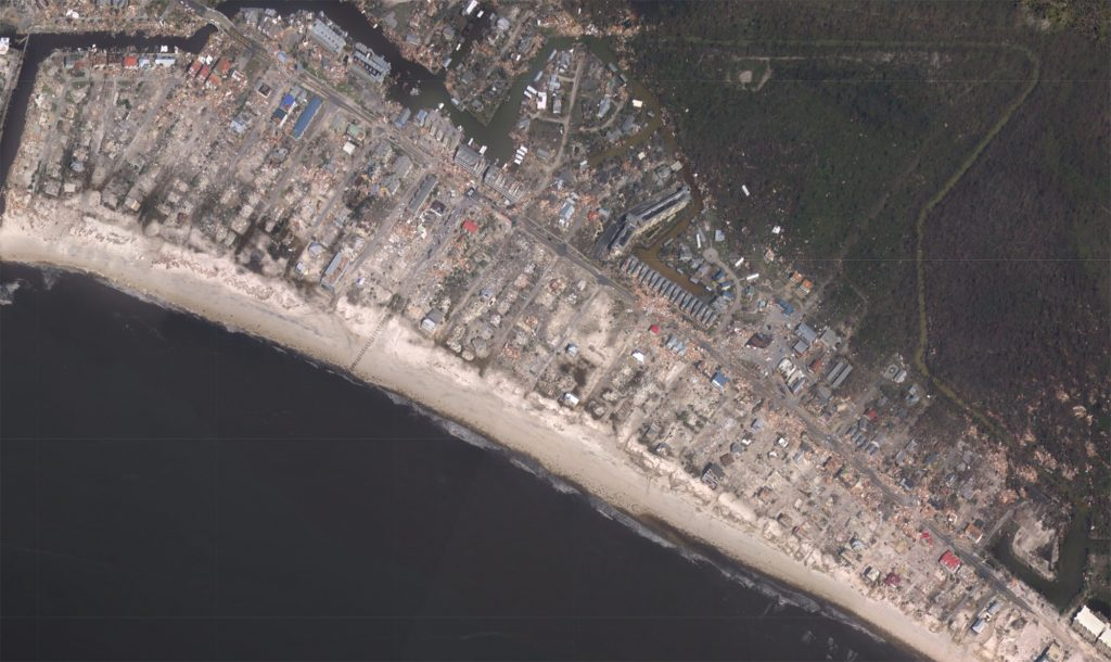 satellite image of destruction of houses along the Mexico Beach.