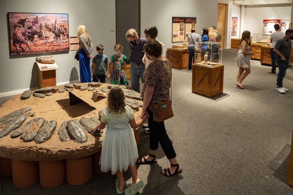 people walking around exhibit space