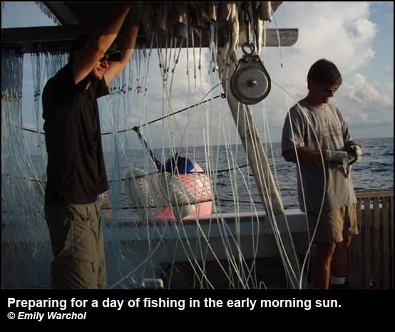 Preparing for a day of fishing in the early morning sun