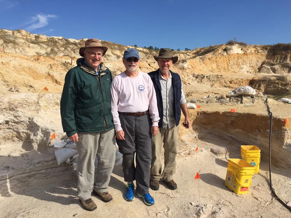 paleontologists at the dig