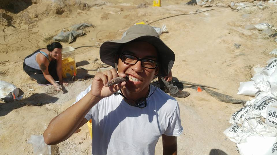 Issac Magallanes with a juvenile gomphothere tusk.