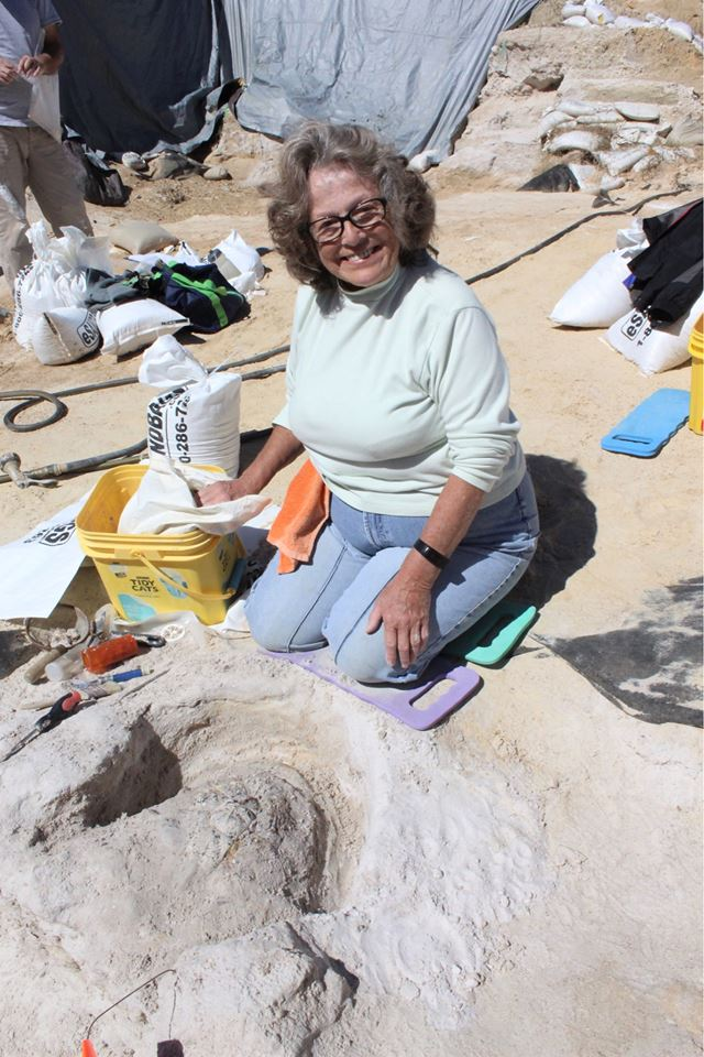 Carol Sewell excavating her square at the dig site.