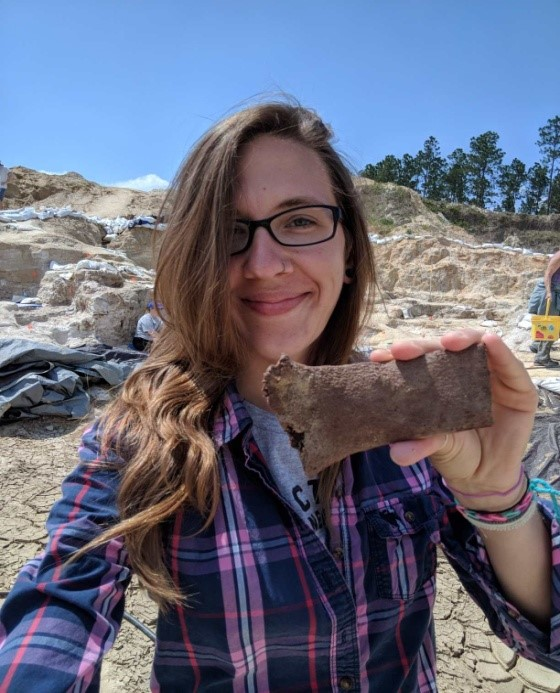 Me holding a piece of the rib of a Gompothere (prehistoric elephant)
