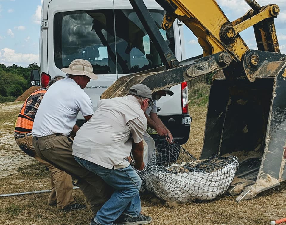 2019-03-26 2019-03-26 The adult gomphothere skull jacket moved out of the excavator bucket with people power. Florida Museum photo by Bill and Carol Sewell