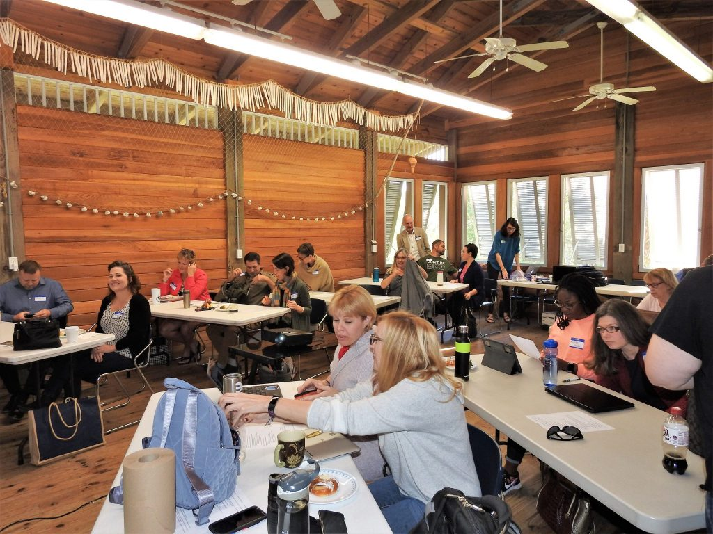 Workshop participants discuss in the Randell Research Center's beautiful classroom.