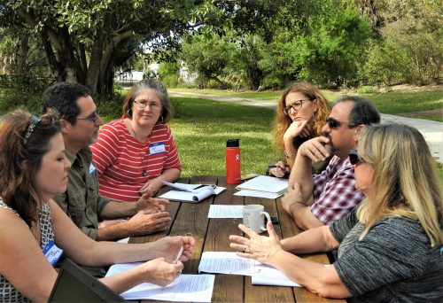 Teachers met in break-out groups to discuss how to implement the moonshot in their classroom.