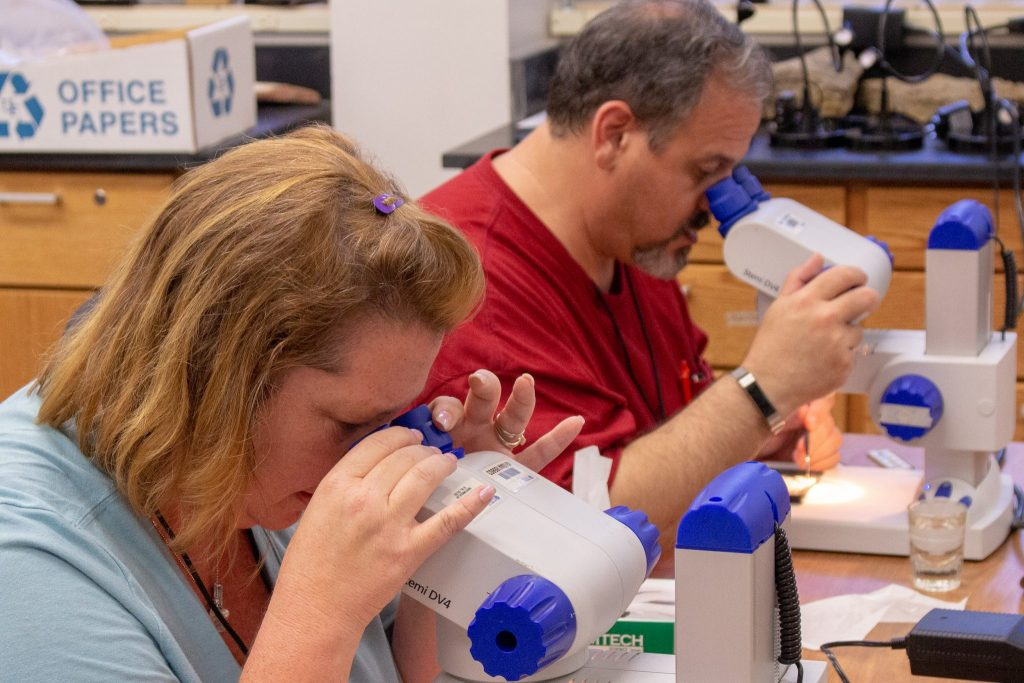 teachers with microscopes