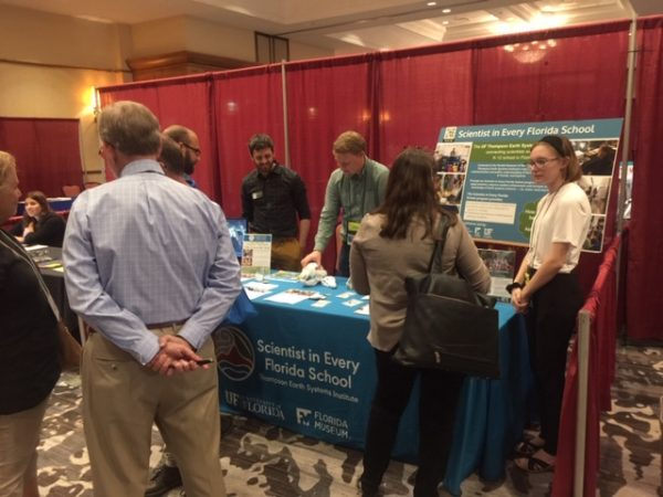 SEFS Team speaks to teachers at booth during conference