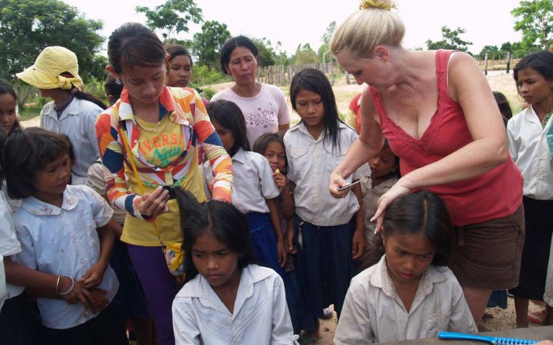 women looking for lice on children