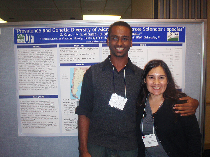 student and researcher presenting poster