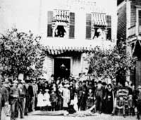 group photo in front of old shell shop