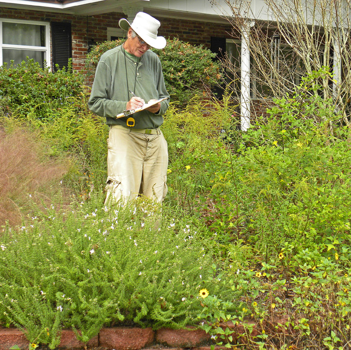 Akers Pence records observations in a landscaped yard for the Plant for Wildlife study.