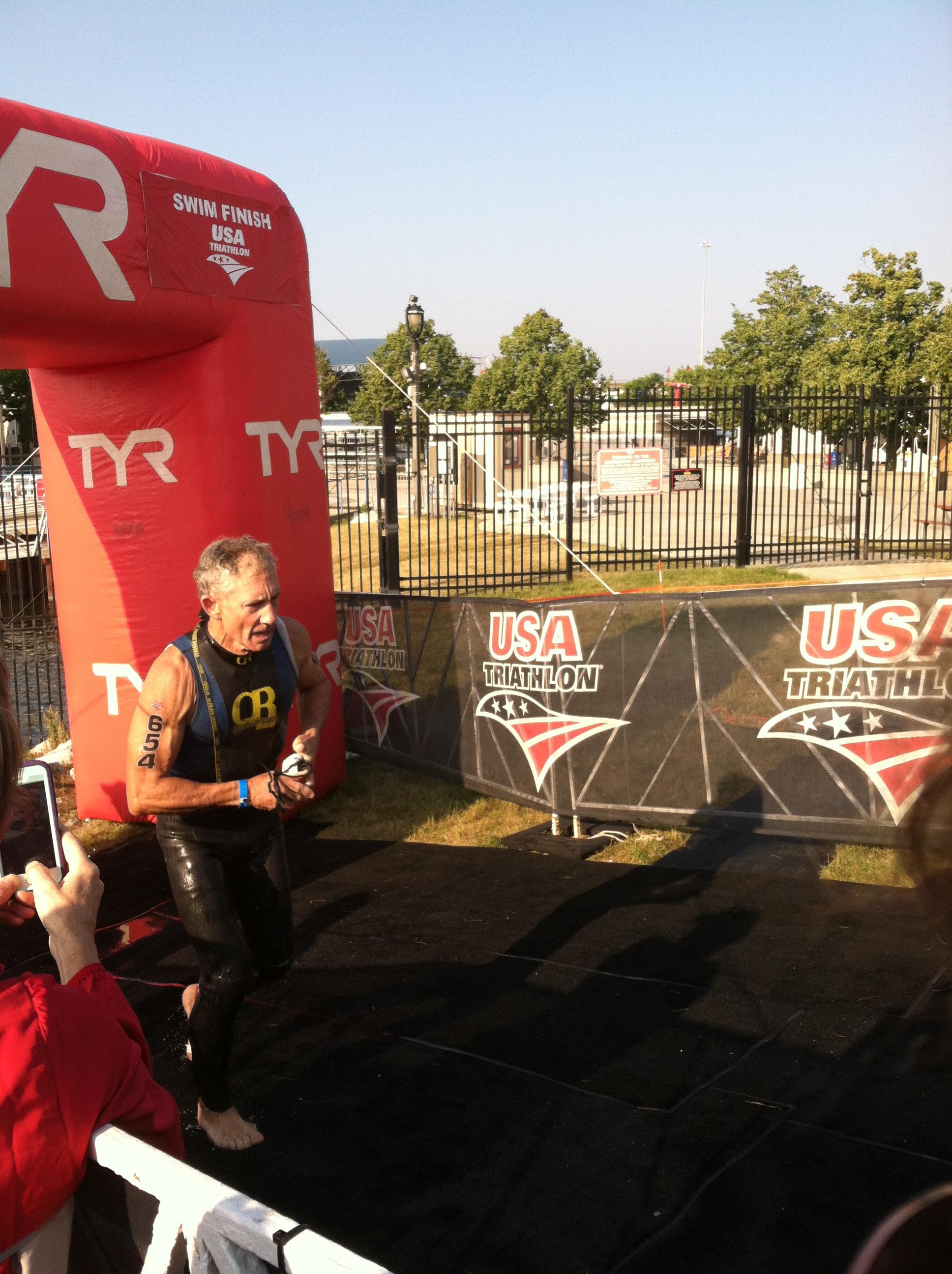 Doug running across the finish line at the triathlon
