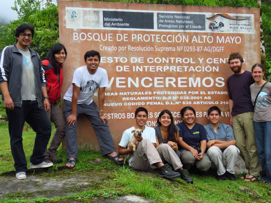 field crew standing in front of the Alto Mayo forest entrance sign
