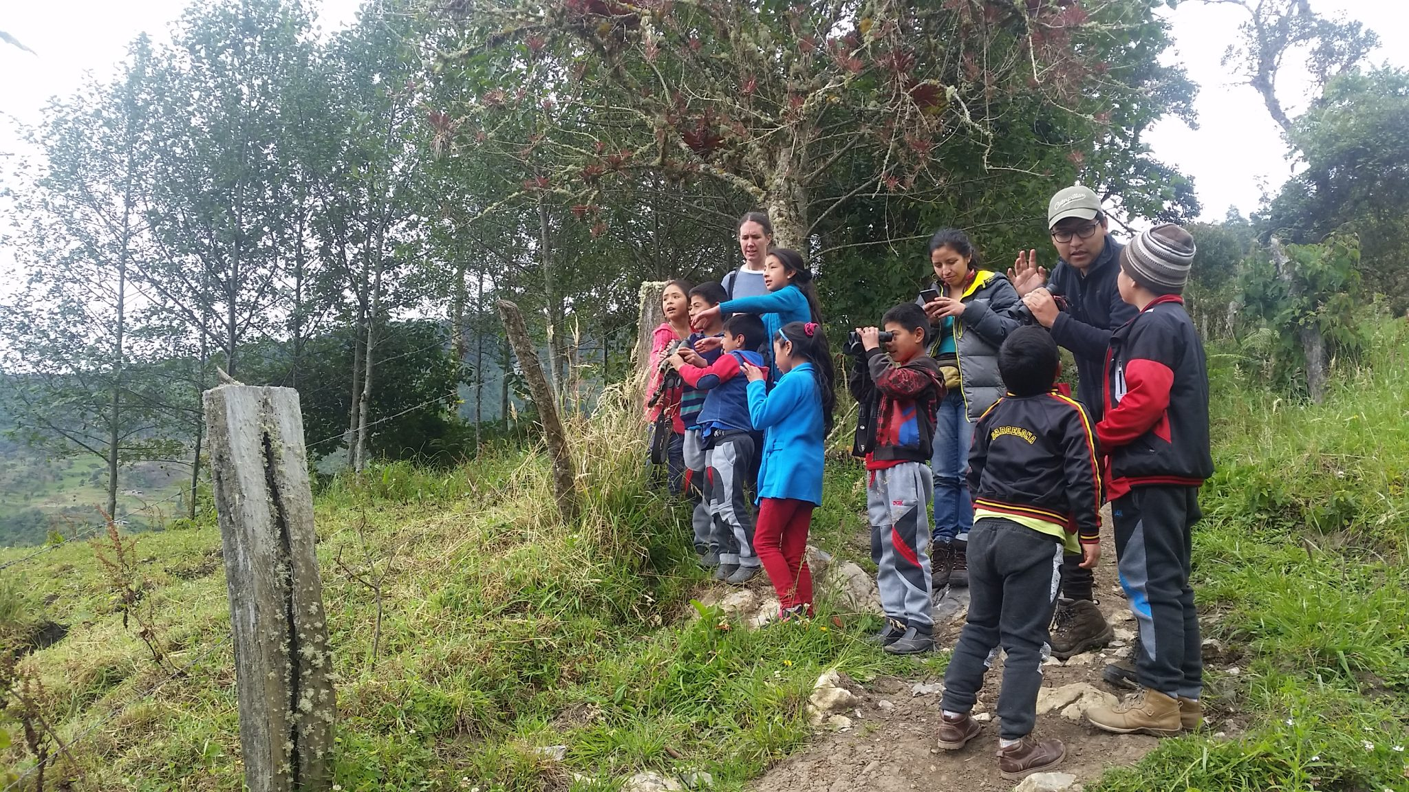 children learning how to use binoculars